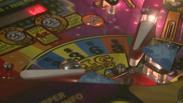kdvr closeup shots of a boy playing on a pinball machine in denver colorado on march 30 2016 - pinball machine stock videos & royalty-free footage