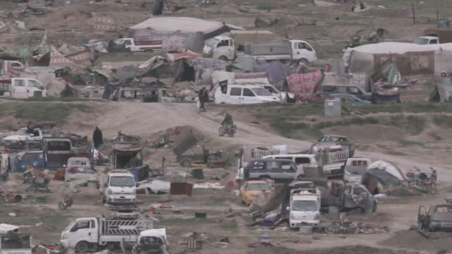 stockvideo's en b-roll-footage met closeup shots of the isis stronghold in baghouz syria on march 8 2019 - war or terrorism or military