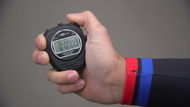 close-up showing a man wearing elastane clothing starting a stopwatch at a velodrome, uk. - stop watch stock videos & royalty-free footage