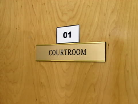 closeup sign hanging on courtroom door/ guantanamo bay guantanamo province cuba - guantanamo bay stock videos & royalty-free footage