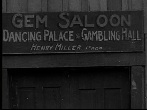 1915 b/w close-up sign hanging outside saloon  - western script stock videos & royalty-free footage