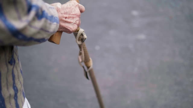 close-up : slow motion an asian older lady walks exercise in morning hands on walking stick. - telecamera traballante video stock e b–roll