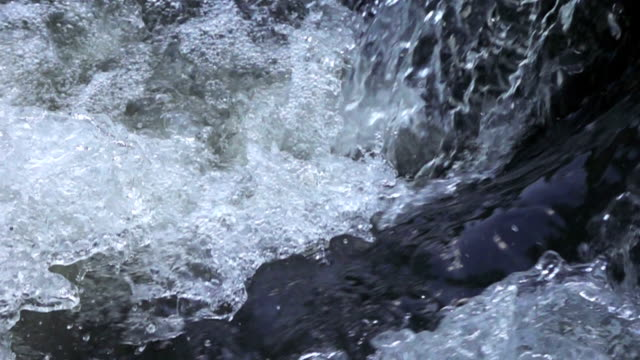 close-up slow motion waterfall. - flowing water stock videos & royalty-free footage