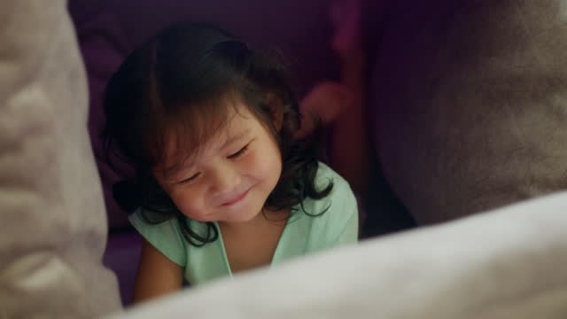close-up smiling toddler girl watching cartoon on mobile phone. digital native. addict - digital native stock videos & royalty-free footage