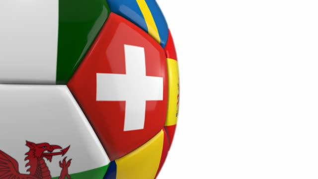 vídeos de stock, filmes e b-roll de close-up de bola de futebol com bandeiras/circulares - 4 k - euro 2016