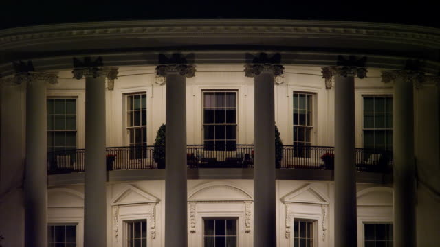 Close-up South Portico of the White House at night, fountain splashing up in lower frame. Shot in 2012.