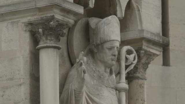 close-up static shot of a stone bishop figurine on notre dame de paris, france. - circa 12th century stock videos and b-roll footage