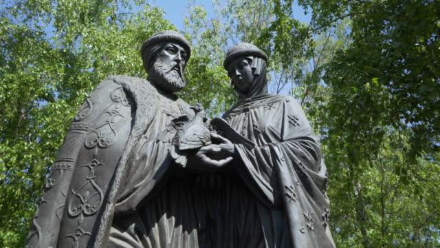 close-up: statue of saints holding two birds  - irkutsk, russia - heiliger stock-videos und b-roll-filmmaterial