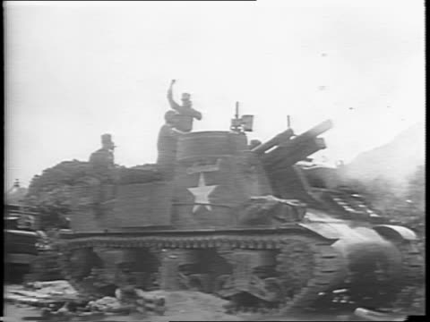 close-up sticks hit drum / soldier raises the us flag / troops salute as flag is raised / tank gun fire / impact explodes on field / flamethrowers... - militärisches landfahrzeug stock-videos und b-roll-filmmaterial
