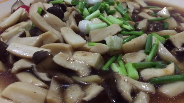 close-up stir fried fresh shiitake mushrooms  in garlic herb and olive oil with soy sauce - savory food stock videos & royalty-free footage
