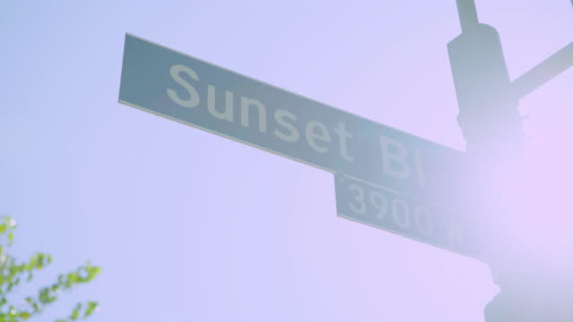 close-up: street sign (shot on red) - sunset boulevard stock-videos und b-roll-filmmaterial