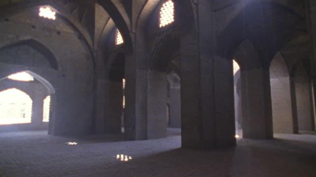 1999 close-up sunlight streaming into windows of ancient mosque/ yazd, iran - モスク点の映像素材/bロール