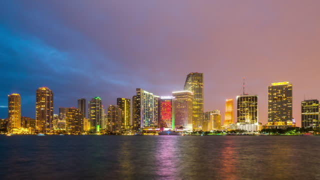 close-up sunset time lapse over miami downtown waterfront side, florida. usa - マイアミ点の映像素材/bロール