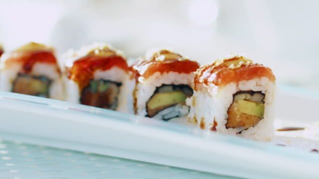 close-up: sushi roll (shot on red) - sushi stock videos and b-roll footage
