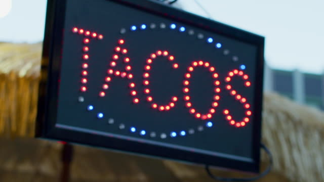close-up: tacos sign (shot on red) - accessibility stock videos and b-roll footage