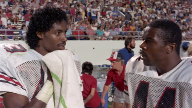 1985 Close-up Tampa Bay Bandits football players talking during game against Orlando Renegades / USA