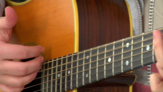 close-up teenage girl playing acoustic guitar / brooklyn, new york, usa - mid length hair stock videos & royalty-free footage