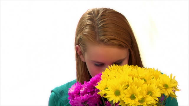 close-up teenage girl smelling bouquet of brightly colored daisies / brooklyn, new york, usa - one teenage girl only stock videos & royalty-free footage