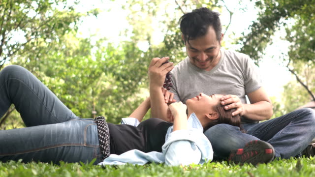 close-up: thai husband is teasing his wife by grape - teasing stock videos & royalty-free footage