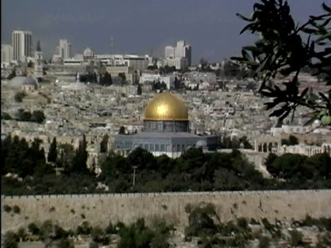 a close-up that zooms out from dome of the rock and incorporates the city of jerusalem - onion dome stock videos and b-roll footage