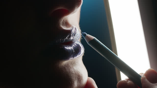 close-up. the make-up artist draws on the lips with a blue lip liner. - lip liner stock videos & royalty-free footage