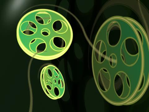 close-up three film reels spinning - 少数の物点の映像素材/bロール