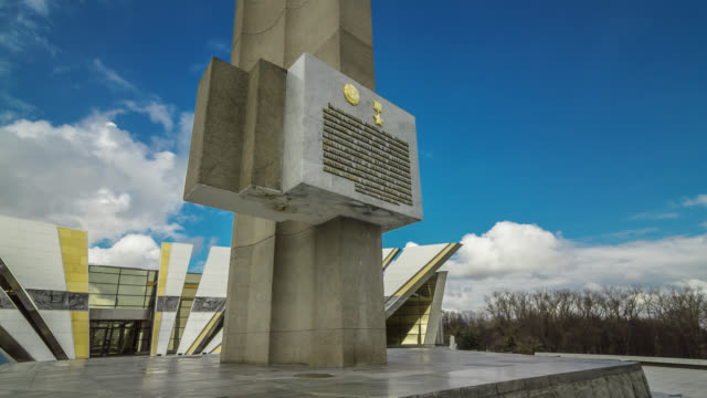 Close-up time lapse of the obelisk «Minsk is the Hero-city» with Belarusian State Museum of the Great Patriotic War History. Belarus.