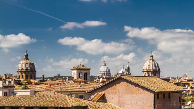 Close-up Timelapse of clouds over the roman roofs and Vatican Saint Peter's basilica Dome. Rome, Italy. April, 2016.
