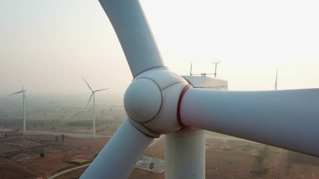 close-up to a windmill in wind turbines farm, zoom out - wind turbine stock videos & royalty-free footage