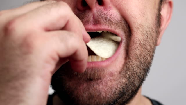 closeup to man enjoy eating - snack stock videos & royalty-free footage