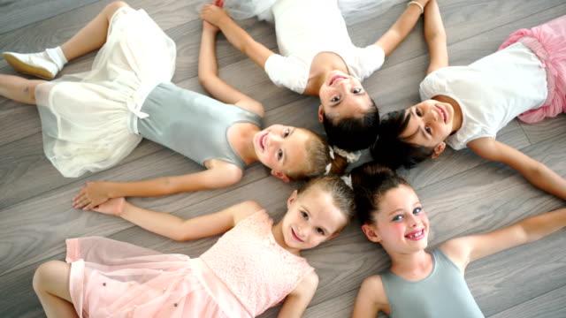 little ballerinas. - lying down stock videos & royalty-free footage