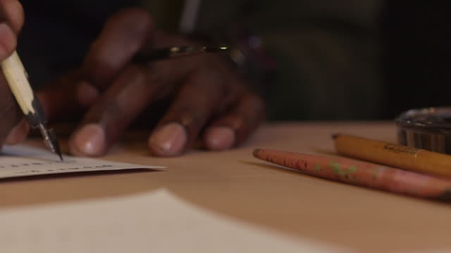 close-up track right to left over a calligrapher at work, uk. - craftsperson stock videos & royalty-free footage