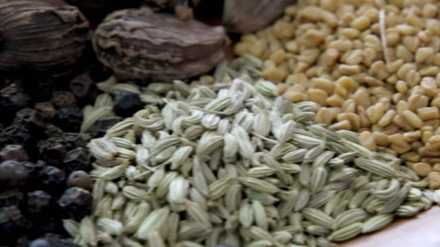 A close-up tracking shot through various Indian spices and masalas