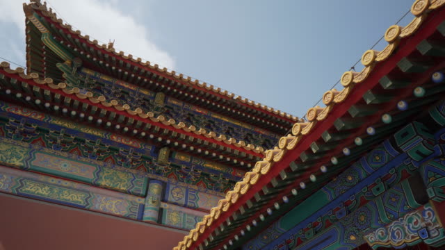 close-up: traditional building with colorful roof at forbidden city against sky - beijing, china - forbidden city stock videos & royalty-free footage