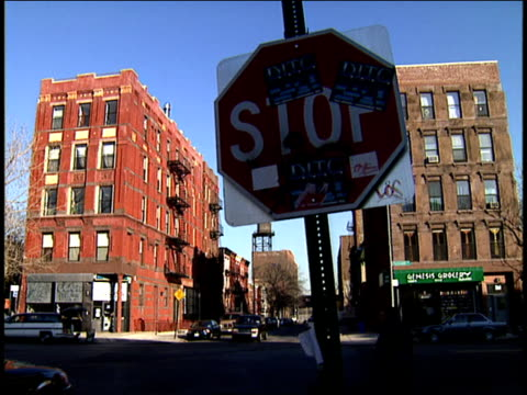 2001 close-up traffic crossig intersection near stop sign/ harlem, manhattan, new york, usa - ハーレム点の映像素材/bロール