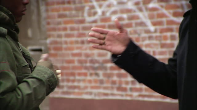 close-up two men giving each other street handshakes / new york city, new york, usa - brother stock videos & royalty-free footage