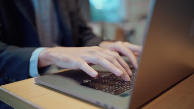 close-up, typing on laptop keyboard - escape key stock videos & royalty-free footage