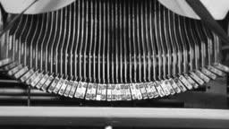 Close-up. typing the old metal typewriter, retro style