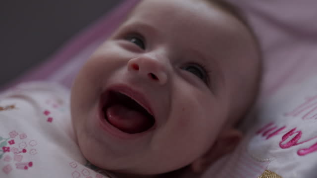 close-up video of a little baby smiling and laughing - ridere video stock e b–roll