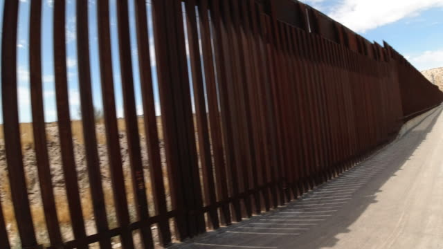 closeup video of the international border wall separating sunland park, new mexico and port anapra, mexico - international border stock videos & royalty-free footage