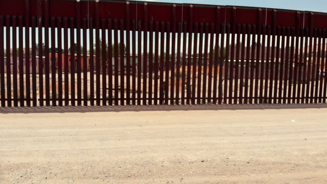 closeup video of the international border wall separating sunland park, new mexico and port anapra, mexico - international border barrier stock videos & royalty-free footage