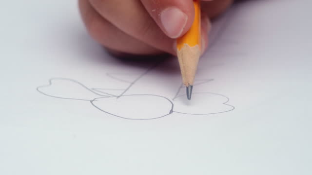 closeup video of the little boy's hand, drawing with a pencil. - close to stock videos & royalty-free footage