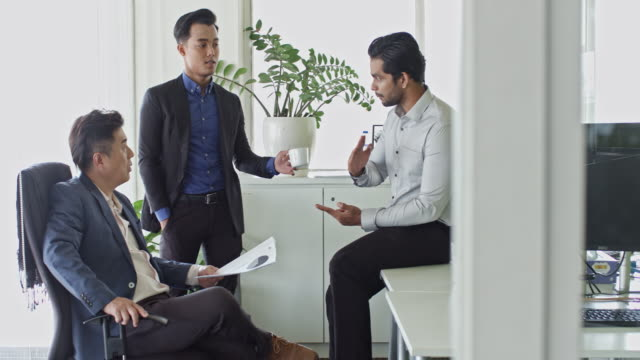 close-up video of three multi-ethnic malaysian businessmen brainstorming at office - office partition stock videos & royalty-free footage