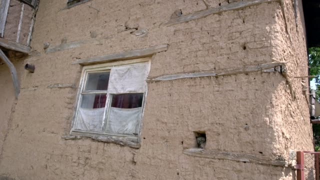 stockvideo's en b-roll-footage met close-up view of a partially ruined, brick house in the old village of mandritsa, eastern rhodope mountains, bulgaria - kassei