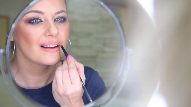 closeup view of a professional makeup artist applying lipstick on model's lips working in beauty fashion industry - lipstick stock videos & royalty-free footage