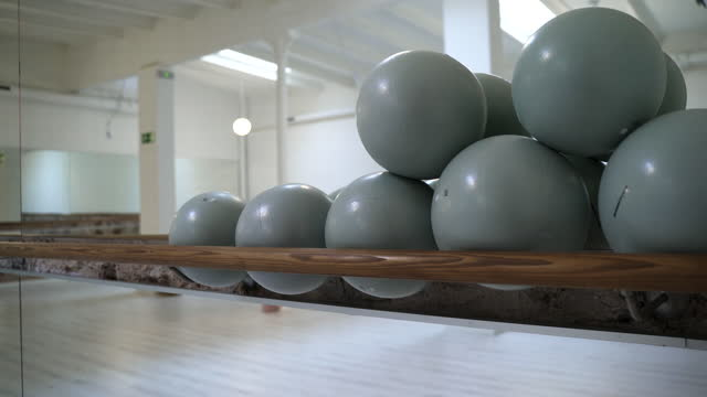 close-up view of a set of fitness balls. - barre stock videos & royalty-free footage
