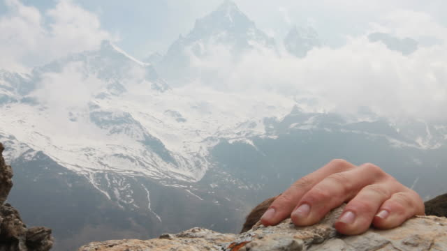 Close-up view of climber's hand and face, during ascent
