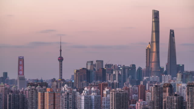 close-up view of crammed shanghai city skyline sunset to night transition - sunset to night stock videos & royalty-free footage