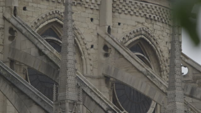 Close-up view of flying buttresses on the side of Notre Dame de Paris, France.