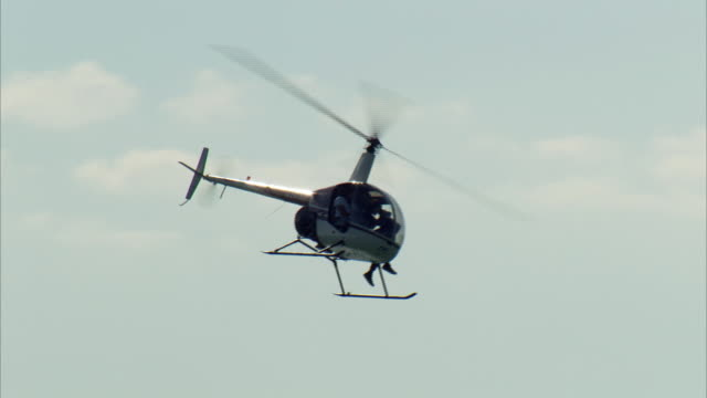 close-up view of flying helicopter in miami, florida - tourism stock videos & royalty-free footage